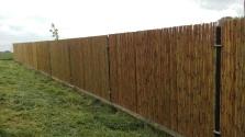 Rhabillage de clôture en Bambou vernis